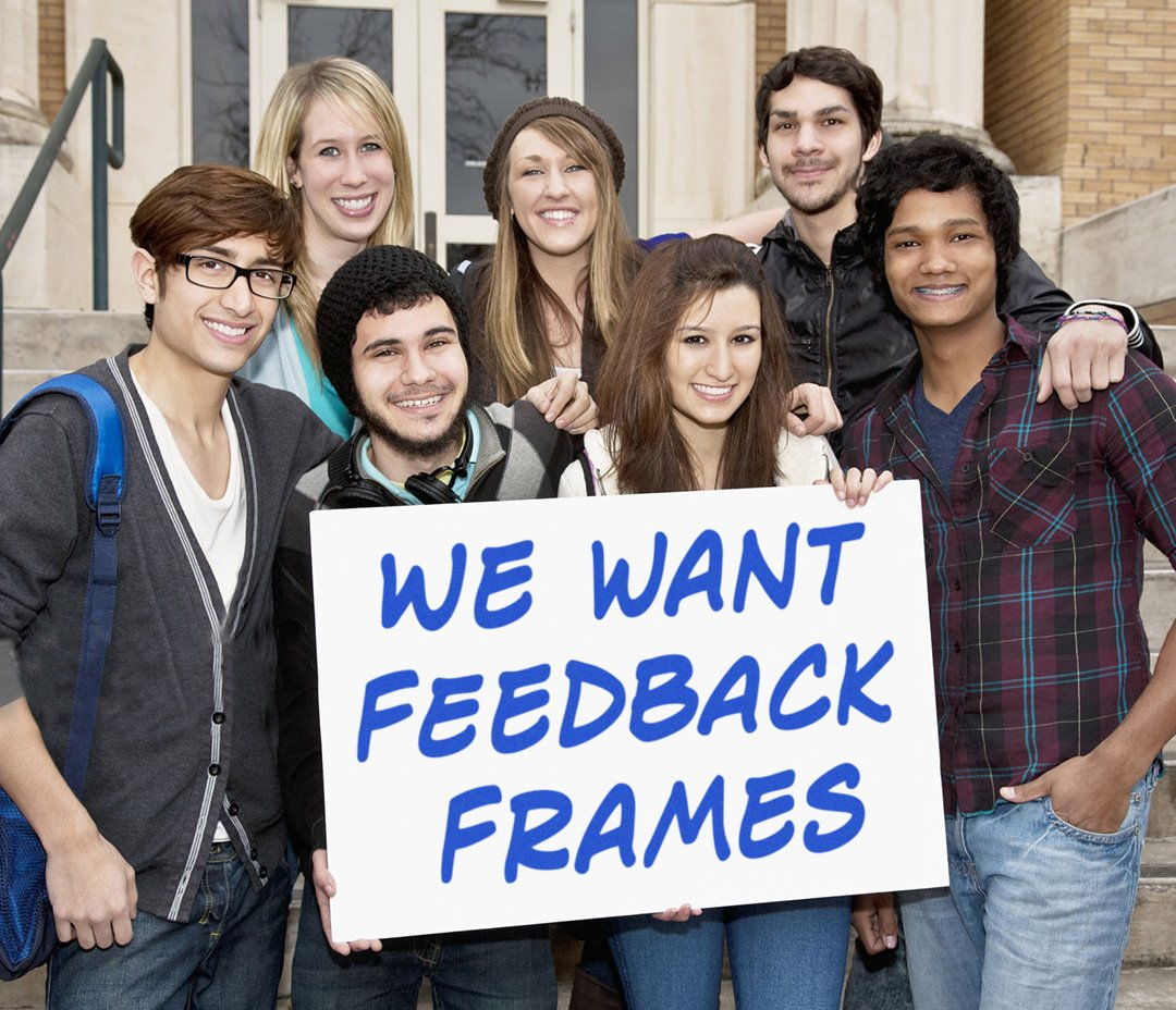 Group with sign saying we want Feedback Frames